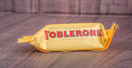 owned: TOKYO, JAPAN - 4TH OCTOBER 2015. Created by Theodor Tobler in 1908, Toblerone is a Swiss triangular chocolate bar brand owned by American Mondelez International. Editorial