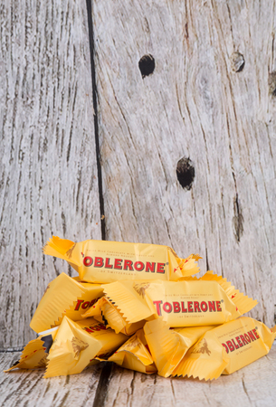 theodor: TOKYO, JAPAN - 4TH OCTOBER 2015. Created by Theodor Tobler in 1908, Toblerone is a Swiss triangular chocolate bar brand owned by American Mondelez International. Editorial