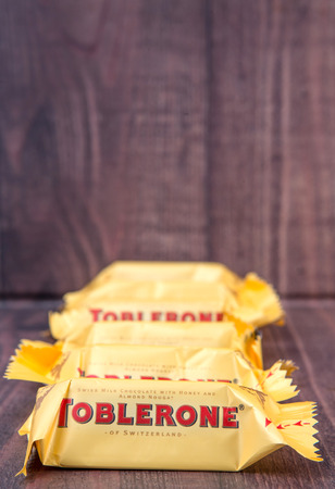 chocolate peak: TOKYO, JAPAN - 4TH OCTOBER 2015. Created by Theodor Tobler in 1908, Toblerone is a Swiss triangular chocolate bar brand owned by American Mondelez International. Editorial