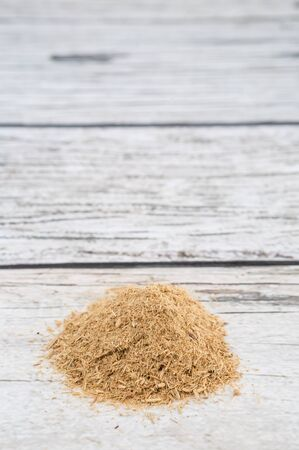 repellant: Lemongrass powder over wooden background