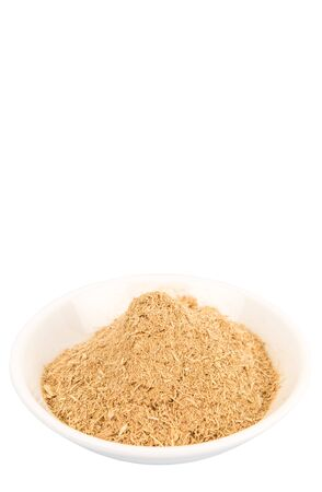 repellant: Dried lemongrass powder in a white bowl over white background