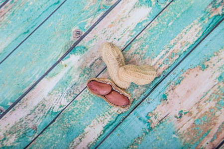 ground nut: Peanut or ground nut over wooden background