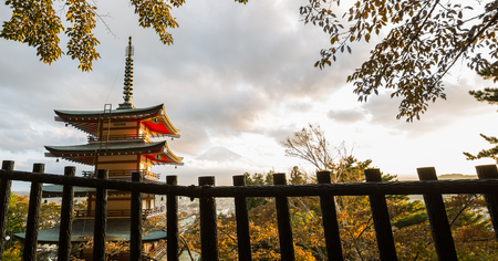 fuji san: Red pagoda with Mount Fuji in the background in autumn Editorial
