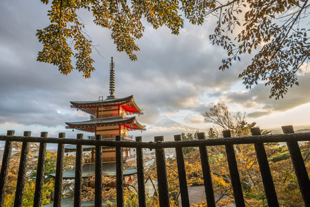 fujisan: Red pagoda with Mount Fuji in the background in autumn Editorial