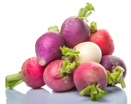Pink, red, dark red, purple, and white radish vegetable over white background