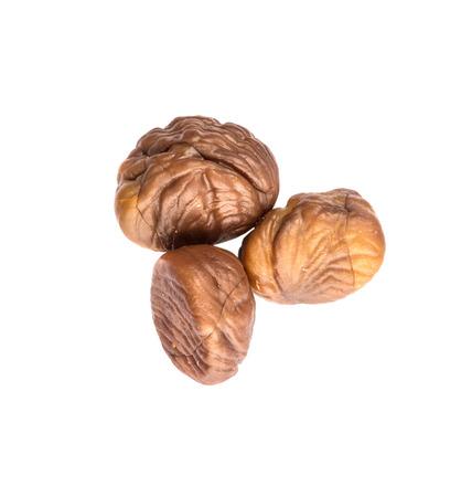 flesh colour: Roasted whole peeled chestnut over white background Stock Photo