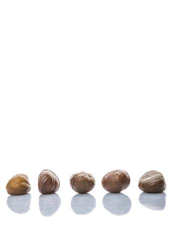 keywords background: Roasted whole peeled chestnut over white background Stock Photo
