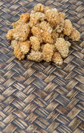 superfruit: Dried white mulberry over wicker background