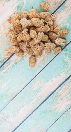 superfruit: Dried white mulberry over wooden background
