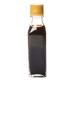 balsam: Balsam vinegar in glass bottle over white background Stock Photo