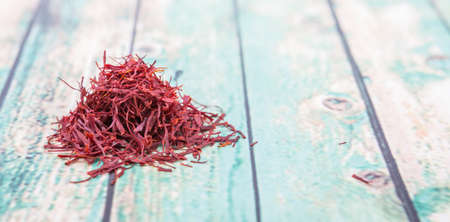 safran: Dried saffron spices over wooden background Stock Photo