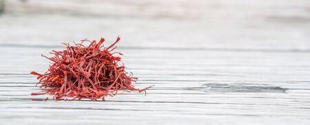 safran: Dried saffron spice over wooden background