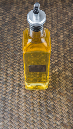 cooking oil: Vegetable cooking oil over wicker background Stock Photo