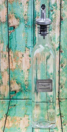 acetic acid: White vinegar over wooden background