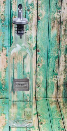 vertical wellness: White vinegar over wooden background
