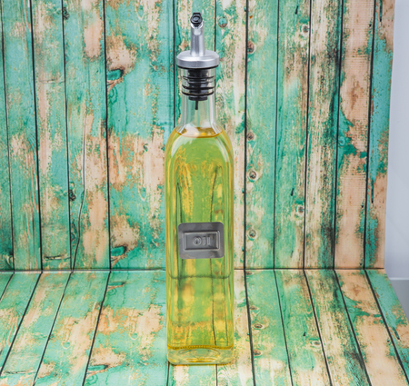 cooking oil: Vegetable cooking oil over wooden background