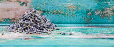 lavender flower: Dried lavender herbal tea over wooden background Stock Photo