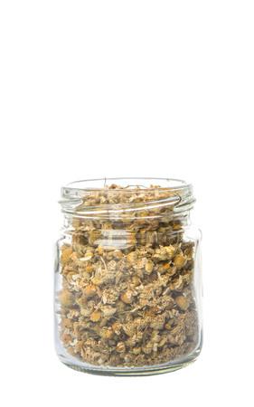 chamomile tea: Dried chamomile tea herbs in mason jar over white background