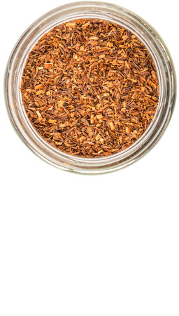 red bush tea: Dried rooibos herbal tea in mason jar over white background