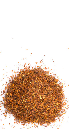 Dried rooibos herbal tea leaves over white background