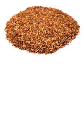 rooibos: Dried rooibos herbal tea leaves over white background