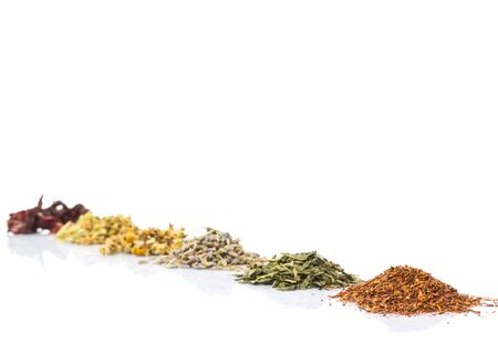 Dried herbal tea leaves, lavender, rooibos, chamomile, linden flower, hibiscus, Japanese green tea over white background
