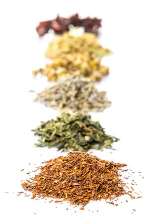 rooibos: Dried herbal tea leaves, lavender, rooibos, chamomile, linden flower, hibiscus, Japanese green tea over white background