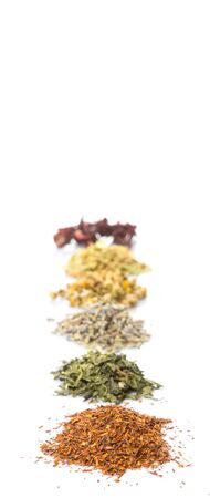 chamomile flower: Dried herbal tea leaves, lavender, rooibos, chamomile, linden flower, hibiscus, Japanese green tea over white background