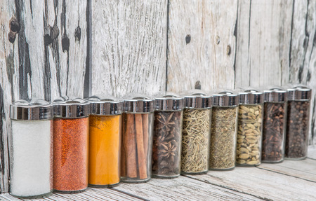 food storage: Spices variety over wooden background