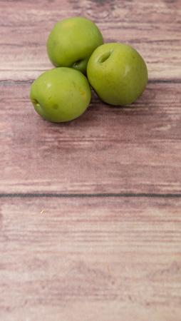 pickled: Pickled olive over wooden background Stock Photo