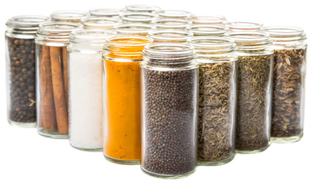 food additives: Dried spices and herbs variety over white background