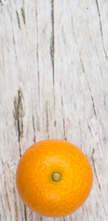 cumquat: Kumquat fruit over wooden background Stock Photo