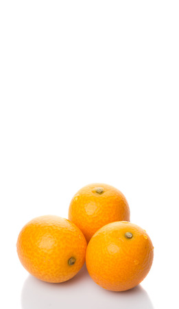 cumquat: Fresh kumquat fruits over white background
