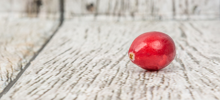 cranberry fruit: Cranberry fruit over wooden background