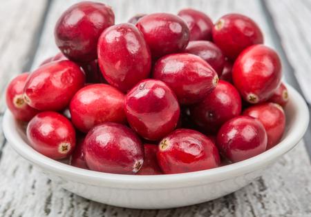 superfruit: Cranberries fruit over wooden background Stock Photo