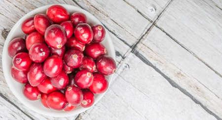 cranberries: Cranberries fruit over wooden background Stock Photo