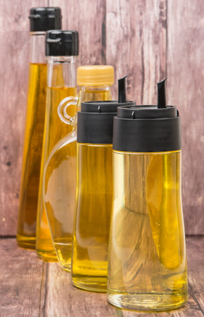 gold flax: Sesame seed oil, corn oil, flax seed oil, corn oil, vegetable oil over wooden background