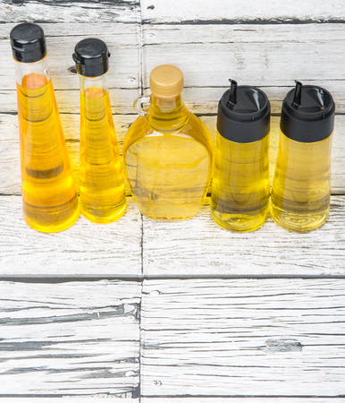 flax seed oil: Sesame seed oil, corn oil, flax seed oil, corn oil, vegetable oil over wooden background