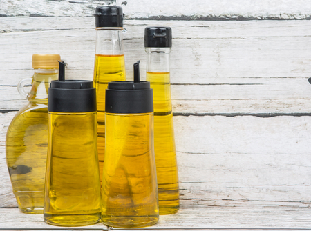 flax seed oil: Sesame seed oil, corn oil, flax seed oil, olive oil, vegetable cooking oil over wooden background