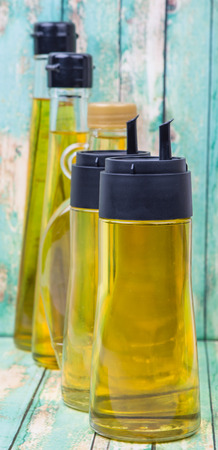 gold flax: Sesame seed oil, corn oil, flax seed oil, olive oil, vegetable cooking oil over wooden background