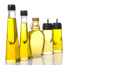 flax seed oil: Sesame seed oil, flax seed oil, olive oil, corn oil and vegetable oil in bottles over white background Stock Photo