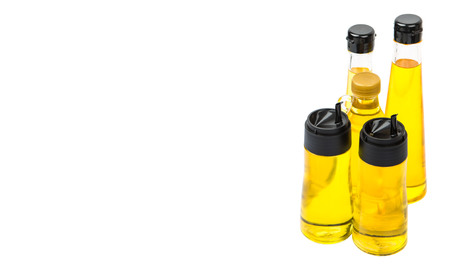 gold flax: Sesame seed oil, flax seed oil, olive oil, corn oil and vegetable oil in bottles over white background Stock Photo