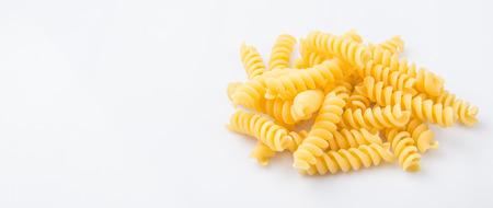 fusilli: Dried corkscrew shape pasta or fusilli pasta over white background Stock Photo