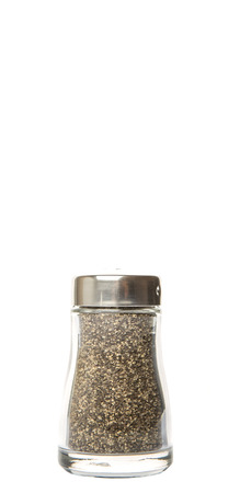 condiment: Peppercorn powder in glass condiment shaker over white background Stock Photo