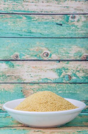 brewers: Dried bakers yeast in wooden bowl over wooden background