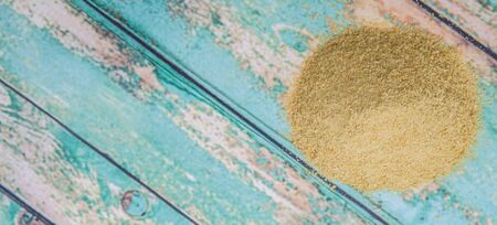 yeast: Dried bakers yeast over wooden background Stock Photo
