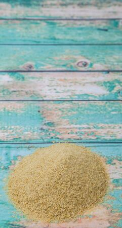 leavening: Dried bakers yeast over wooden background Stock Photo