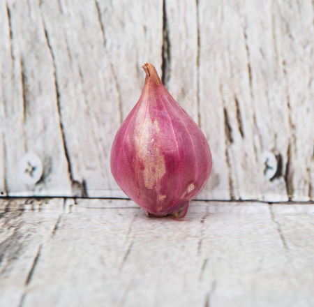 shallots: Shallots over wooden background