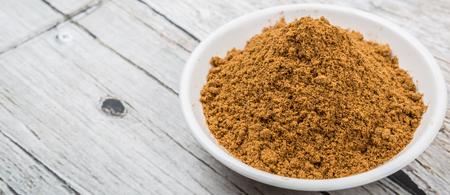 garam: Garam masala or mix spices in white bowl over wooden background