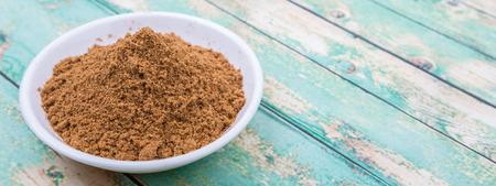 garam: Garam masala or mix spices blend in white bowl over wooden background